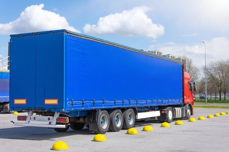 Truck trailer with blue awning trailer for cargo parked
