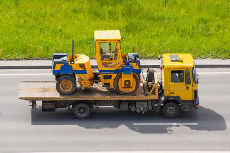 Carriage on a trailer platform of paver roller Stock Photo
