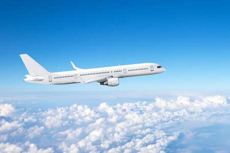 Passenger plane flight high in the sky above cumulus clouds