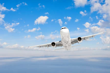 The plane flies straight, gaining altitude through a dense layer of clouds