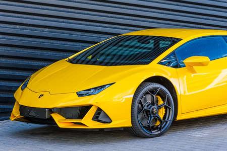 Supercar Lamborghini Aventador yellow color parked at the car dealership. Russia, Saint-Petersburg. 01 June 2020