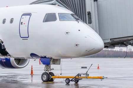 Airplane with TUG carrier for the front landing gear before departure