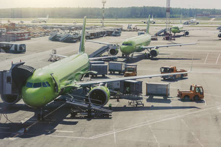 Several planes on the large apron of the international airport Stock Photo