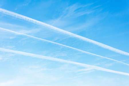 Three jet trails in the blue sky Stock Photo