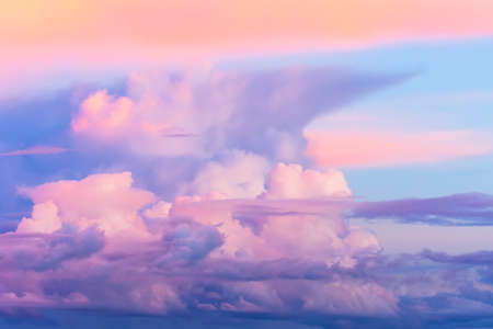 High cumulus clouds stormy during sunset blue purple pink shades, beautiful heavenly view