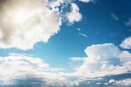 Beautiful sky with powerfully cumulus rainy clouds on a sunny day Stock Photo