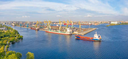 Panoramic aerial view of the industrial city port by the sea