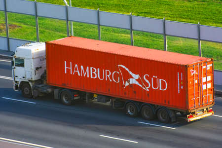 Truck with trailer and green container company Hamburg sud on city highway. Russia, Saint-Petersburg. 24 august 2020 Editorial