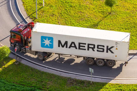 Truck with trailer and green container company Maersk on city highway. Russia, Saint-Petersburg. 24 august 2020