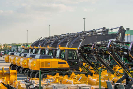 New Excavators are lined up in a parking lot