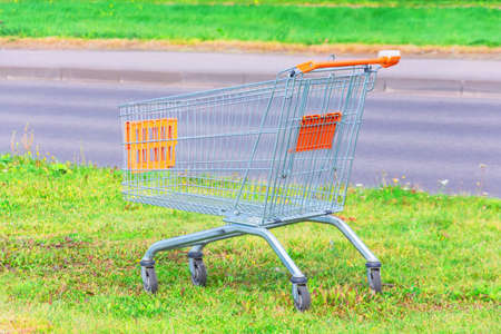 Shopping cart in on the lawn by the store