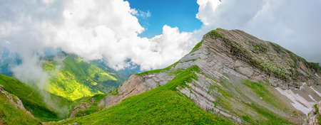 Top of a rocky ridge with alpine meadows, panorama view Stock Photo