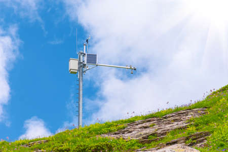Automatic weather station, with a weather monitoring system at the top of the mountain range
