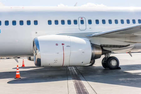 Aircraft engine, wing, landing gear and fuselage with portholes