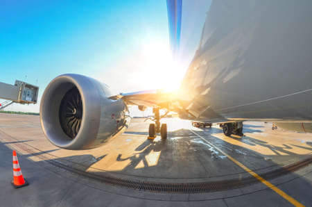 Bright sun over the wing and engine of an airplane at the airport Reklamní fotografie