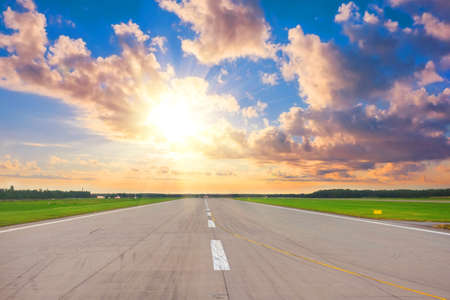 Wide runway view of the sun in the sky above the beautiful horizon, concept, future success beginnings