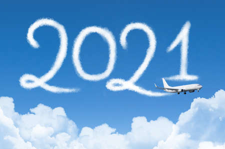 Happy New year 2021 concept travel on the background below cloudscape. Drawing by passenger airplane vapor contrail in sky Zdjęcie Seryjne