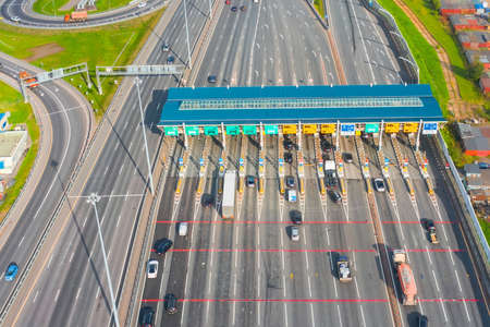 Top view aerial overloaded toll road or tollway on the controlled access highway, forced traffic jam Stock Photo