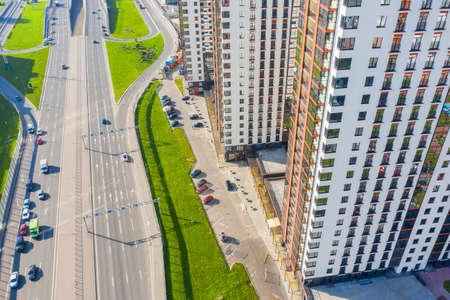 Urban highway car traffic with multi-storey buildings, aerial view