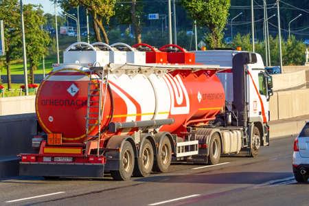 Heavy big fuel tanker truck Lukoil company on city highway. Russia, Saint-Petersburg. 20 august 2020 Editoriali