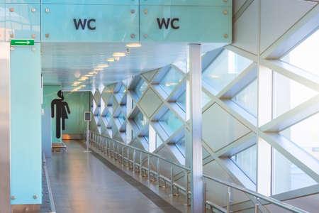 Public building corridor with public toilet and signage 版權商用圖片