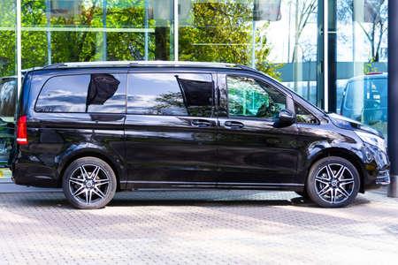 Black Mercedes-Benz V class, side view minivan in a parking lot. Russia, Saint-Petersburg. 14 may 2020