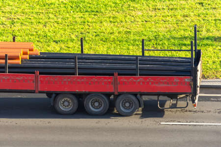 Transportation of propylene water, gas and sewer pipes in a truck trailer