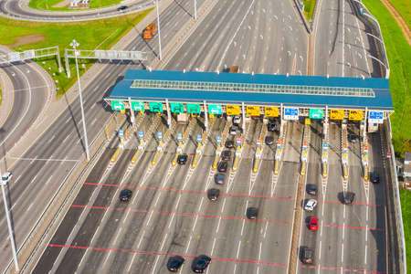 Top view aerial overloaded toll road or tollway on the controlled access highway, forced traffic jam 免版税图像