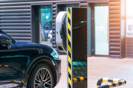 Refueling for electric cars e-mobility, the electric plug under voltage restores the battery charge 免版税图像