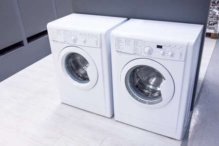 Two washing machines nearby in the apartment