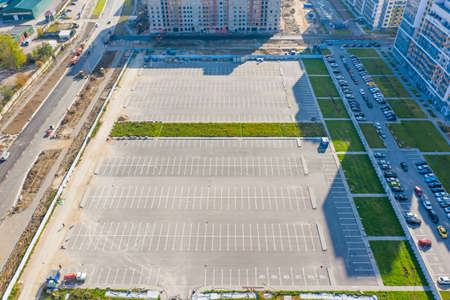 Empty free parking for cars in the open air, in a new residential area, street arrangement Stock Photo