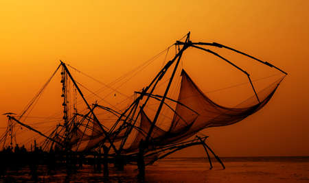 chinese fishing nets: Silhouette of Chinese fishing nets on aserene romantic evening