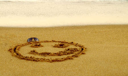 eyewear: Happy Smiling Smiley with Eyewear on a sandy beach