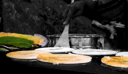 dosa: Preparation of the Indian pizza aka dosa Stock Photo