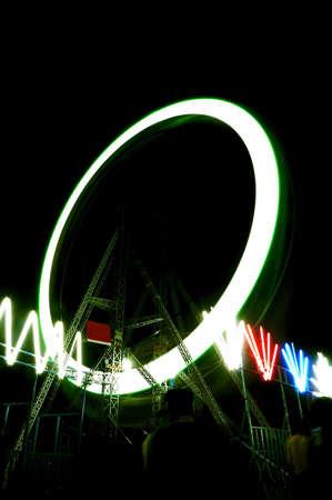 theme park: Motion blur giant wheel at Indian Theme Park Editorial
