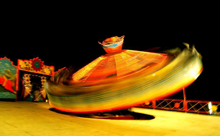 theme park: Spinning in Control: The vibrant colorful dance at an Indian Theme Park