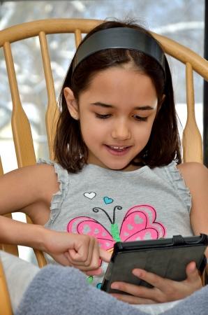 Little Girl Plays Computer Games