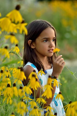 Little Hispanic Girl in the Garden photo