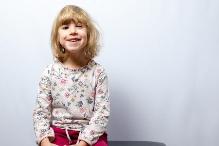 preschool girl studio portrait on clean background