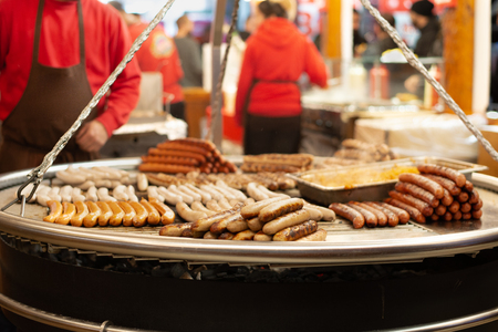Sausages on grill at Evening christmas market Stock Photo