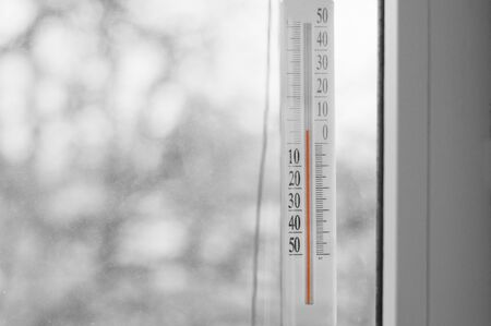 black and white photo thermometer on the window