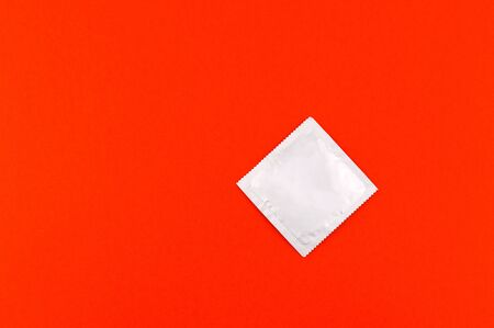 condom on a red background
