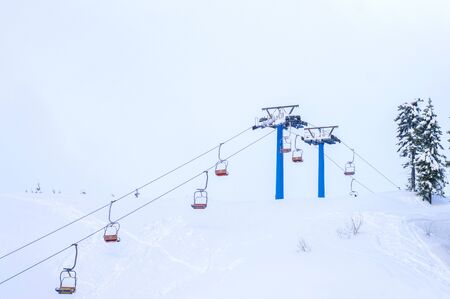 chair lift in winter Imagens