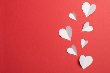 paper hearts on a red background