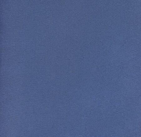 texture of dense blue fabric of thin thread