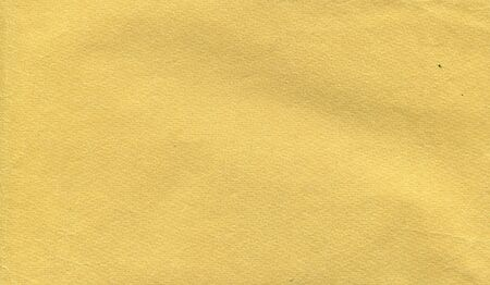 photo texture of old paper in a yellow tint