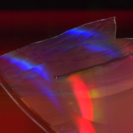 texture of a glossy multi-colored surface of a cd disk with damage 스톡 콘텐츠