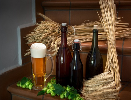still life with bottles and raw material for beer production photo