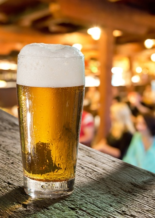 glass of beer in pub photo