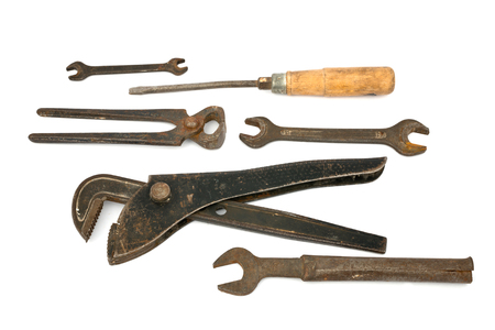 adjustable spanner with old tools  isolated on the white photo